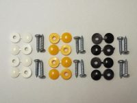 Number Plate Fixing Kit Advertised on https://www.jdmplates.co.uk. This image is showing the items you will receive when purchasing; 12x zinc coated screws with 4x yellow, black & white screw head covers.